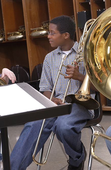 boy playing bass trombone