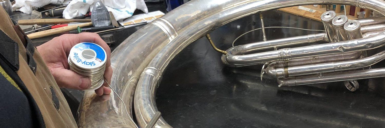 art's music shop tuba repair